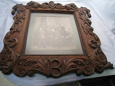 REDUCED antique fabulous  carved oak picture frame with war soldiers photo
