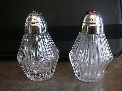 HEISEY CRYSTAL SALT AND PEPPER SHAKERS WITH ORIGINAL SILVER LIDS