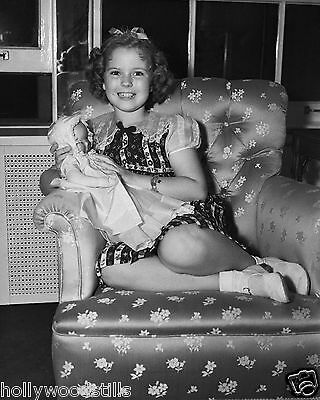 Shirley Temple all smiles sitting in a chair with a baby doll rare 8x10 photo
