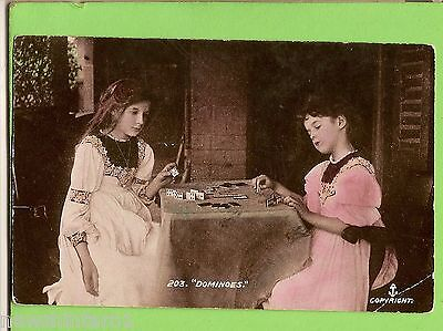 #a.    Postcard -  Two Girls Playing Dominoes