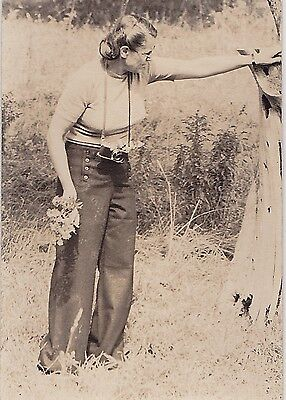 Vintage Antique Photograph Woman With Old Time Camera On Neck Picking Flowers