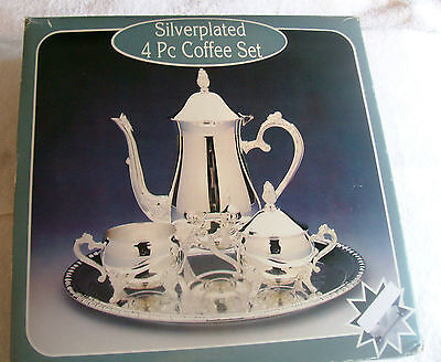 FOUR PIECE SILVERPLATED COFFEE SET, NIB EXCELLENT CONDITION, VERY IMPRESSIVE