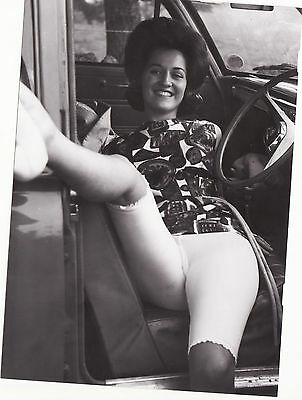 60`s   black and white  vintage amateur glamour  lady at the wheel  photograph