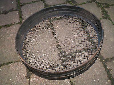 Vintage English 1930's metal garden sieve.