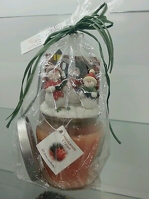 Candle & snowman top New Home Interiors & Gifts