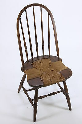 Rush Or Reed Seat Antique Wooden Chair With Turned Spindles And Rounded Back