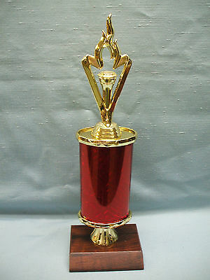 torch red oval column trophy award cherry finish wood base