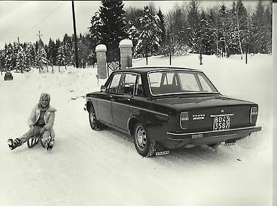 Volvo 144 Original Press Photograph Girl on a Sledge in the Snow Late 1960's