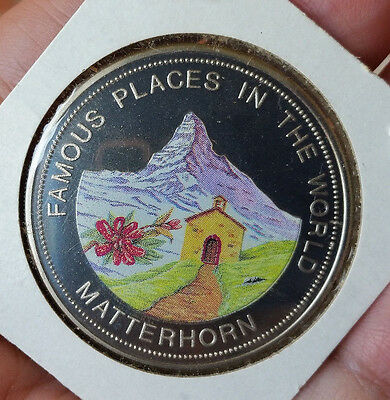Tied for Title: World's 1st Mint Colored Coin 1993 Uganda PROOF 1000S Matterhorn