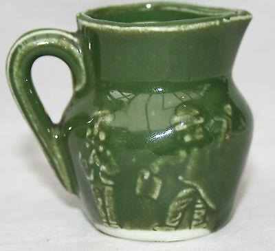 Vintage Miniature Dark Green Pottery Jug with Raised Pattern of Miners?