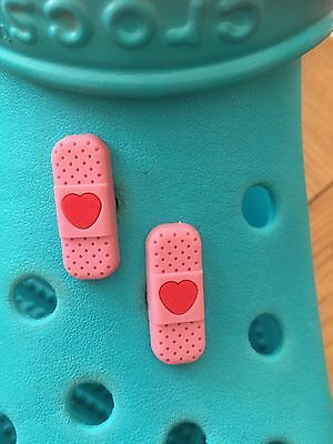 2 Pink Plaster Shoe Charms For Crocs & Jibbitz Wristbands. Free UK P&P.
