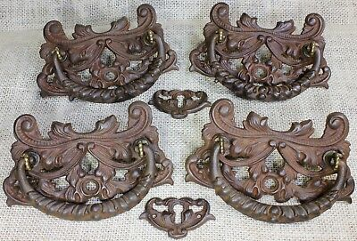 4 Drawer Pulls furniture drop handles 1880's vintage decorated iron 2 keyholes