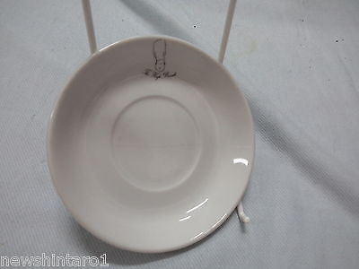 #Qq5. Ceramic Hotel Advertising Ware -  The  High  Bonnet  Saucer