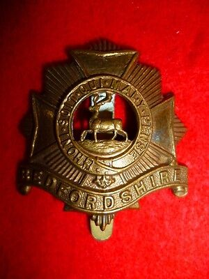 The Bedfordshire Regiment Economy All Brass Voided Cap Badge