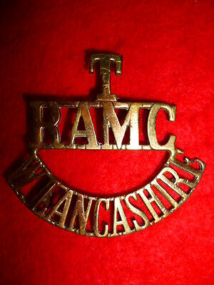 T/RAMC/W.LANCASHIRE Brass Shoulder Title Badge