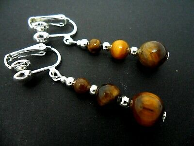 A Pair Of  Tigers Eye  Silver Plated Clip On  Earrings. New.