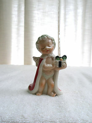 Vintage Porcelain Angel Baby Boy Figurine Holds Present Jewelry Industry Council