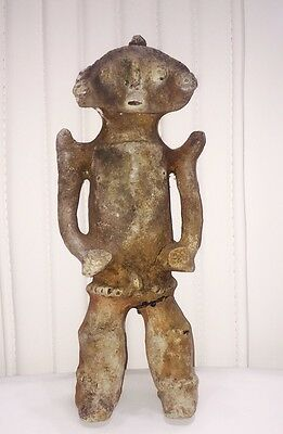 A PRE-COLUMBIAN TERRACOTTA MALE FIGURE, COLOMBIA, CAUCA RIVER c.800-1100AD