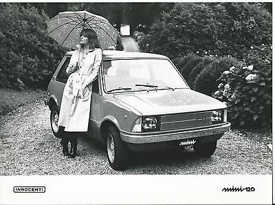 Innocenti Mini 120 Original Press Photograph 1980 Girl in Raincoat With Brolly