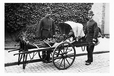 rp3133 - Policemen with a Stretcher Trolley - photograph