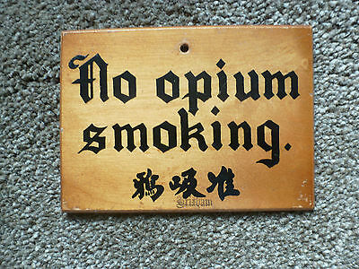 vintage wooden sign 'no opium smoking' and asian language....