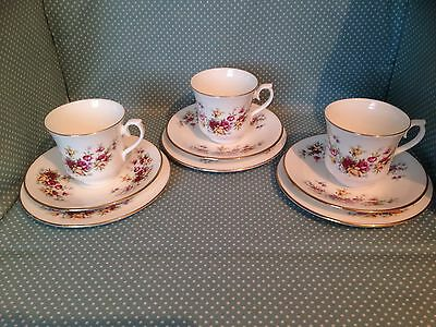 Set of 3 Queen Anne China red & yellow rose cups, saucers & side plates. Trios.