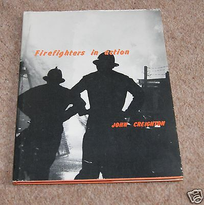 Firefighters in action by John Creighton