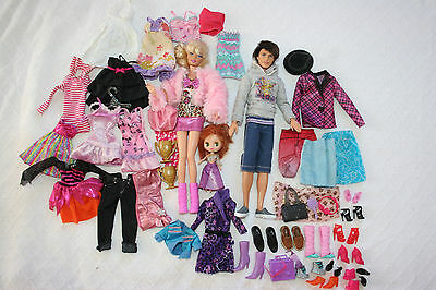 "BARBIE and KEN 12"" dolls & huge lot of clothing & shoes.Different styles,colors"