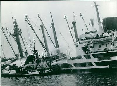 Vintage photo of Cargo ship gutted in fire, 1964.