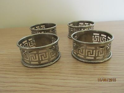 SILVER METAL NAPKIN RINGS WITH KEY PATTERN x 4