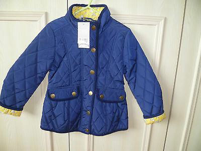 BNWT Girls NEXT Blue Quilted Jacket Floral lining Shower Resistant  5-6 yrs