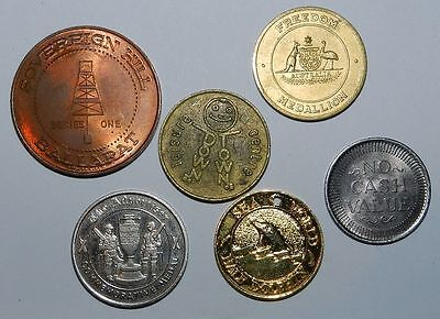GROUP OF 6 VARIOUS TOKENS / MEDALS  - Includes Sea World Half Dolphin Token