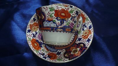 Booth and Co cup and saucer richly coloured in orange, blue and gold