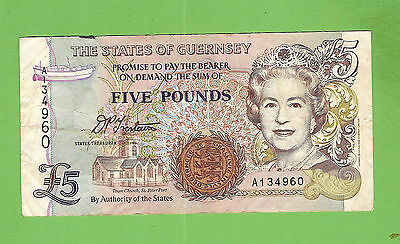 #d235.  The  States Of Guernsey  5  Pound   Circulated   Banknote