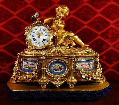 Spectacular antique French Empire 19thc gilt bronze & Sevres mantle clock & base