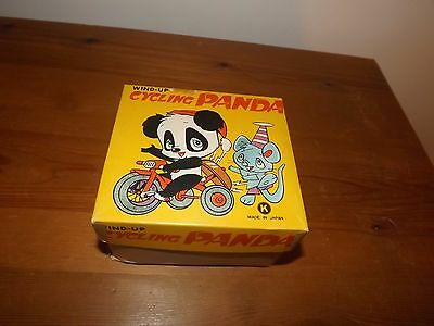 Vintage Wind Up Toy Cycling Panda