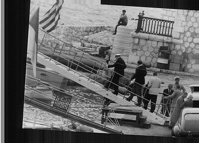 Vintage photo of Winston Churchill boarding on the boat.