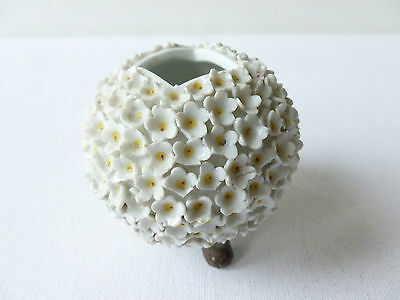Small Round Porcelain Vase? Covered With Little White Flowers on Tripod Legs