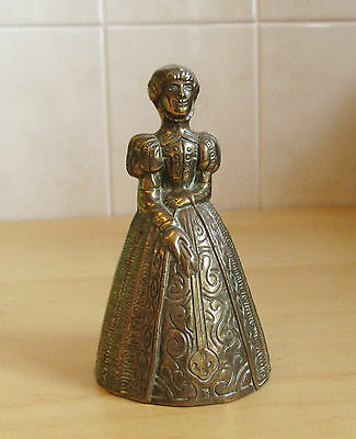 Vintage  brass lady bell with high collar gown and crinoline