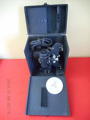 ANTIQUE 8mm BELL & HOWELL FILMO-MASTER MOVIE PROJECTOR W/CASE & NEW REEL WORKS !