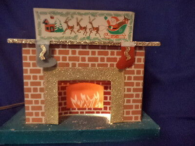 Vintage Lighted  Glittered Cardboard Mica Fireplace, W. Stockings Hung Ornament