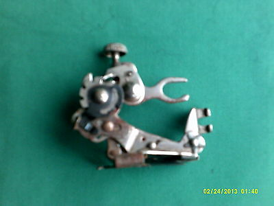 """old sewing machine part, foot? 2 1/4"""" tall"""