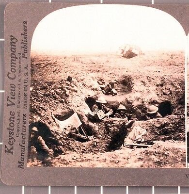 WWI Stereoview card:   British Troops in Shell Hole at Cambrai, Tank in back