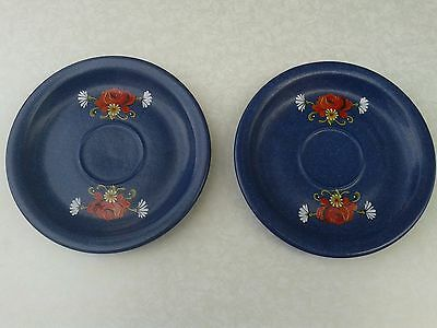 Charming blue pottery saucers with floral decoration