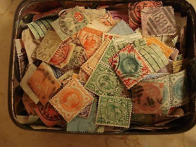 Small tin of over 500 used off paper GB Stamps. No QE2 or commemoratives
