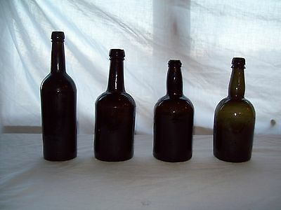 Lot of 4 Antique English black glass blown glass beer bottles 1860's Woolfall