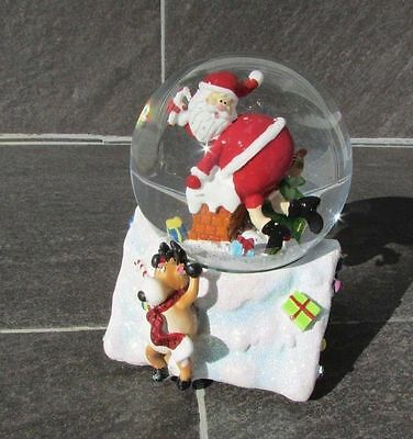 Santa Claus and Reindeer on Rooftop Musical Snow Globe Plays Jingle Bells