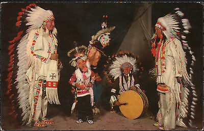 Sioux children learning their culture. Indian picture postcard