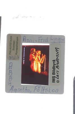 Slide of ABBA members Anni-Frid Lyngstad and Agnetha Fältskog performing on stag