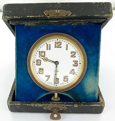 EARLY 1900's LARGE SWISS MADE 15J TRAVEL CLOCK IN ORIGINAL CASE. WORKING.
